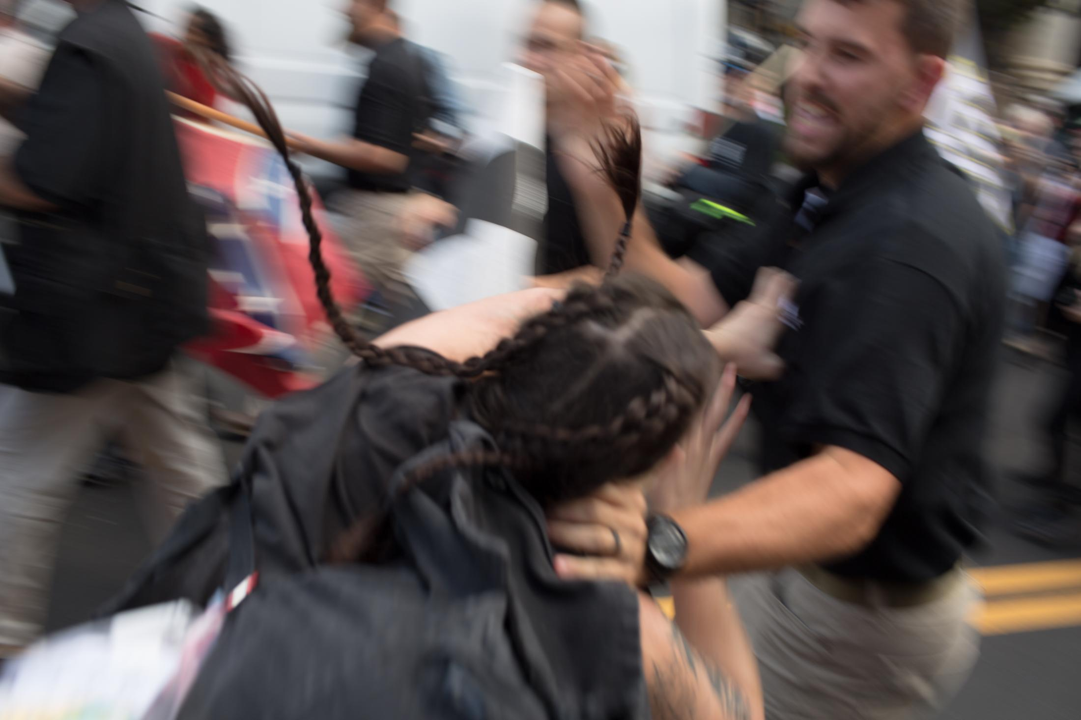 A member of the League of the South and an antifascist protester trade blows during a brawl that broke out after a group of white supremacists were blocked from entering Emancipation Park for the Unite the Right rally in Charlottesville, VA on August 12, 2017.