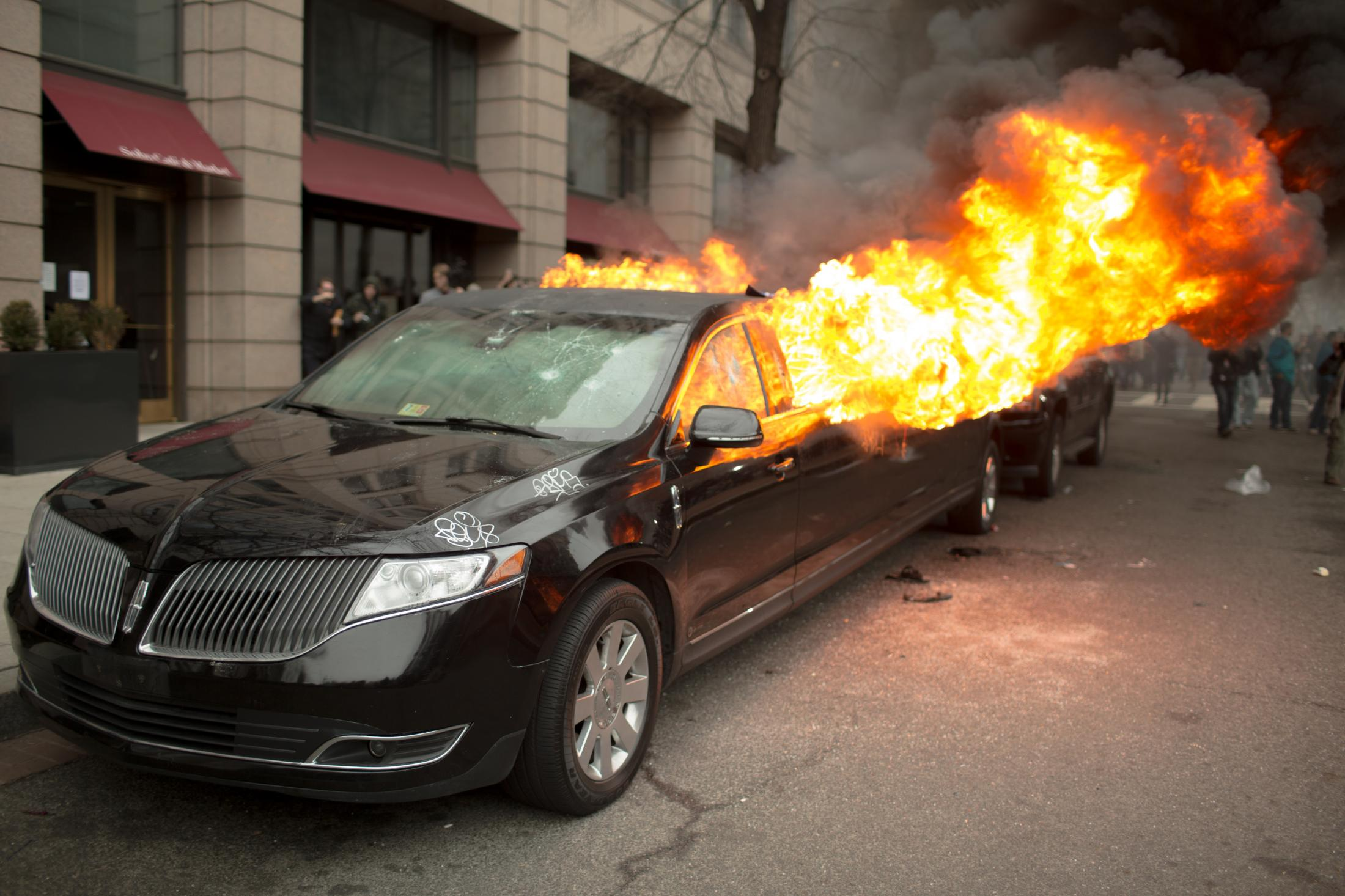 A limo parked on K Street burns set it on fire during violent demonstrations where police and protesters clashed outside of Donald Trump's presidential inauguration in Washington, D.C. on January 20, 2017.