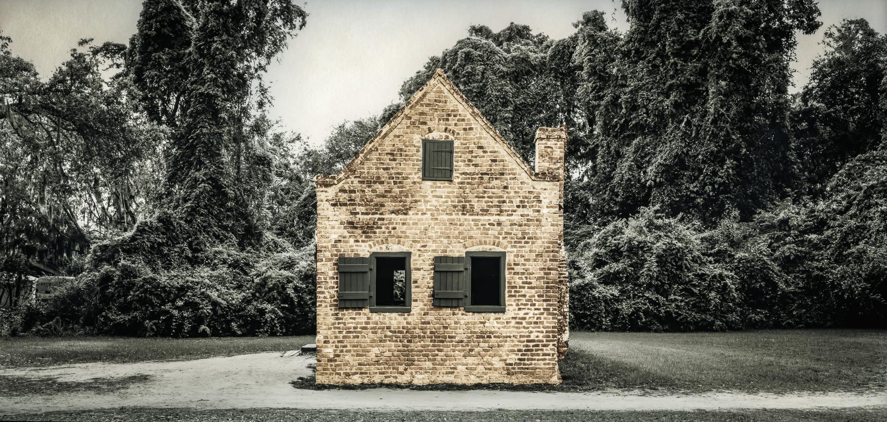 "Slave Dwelling No. 46: Boone Hall Plantation, South Carolina Silver gelatin photograph handprinted from an 8x16"" film negative. The slave cabin was painted with toners to illuminate the structure. To purchase a limited edition photograph click"