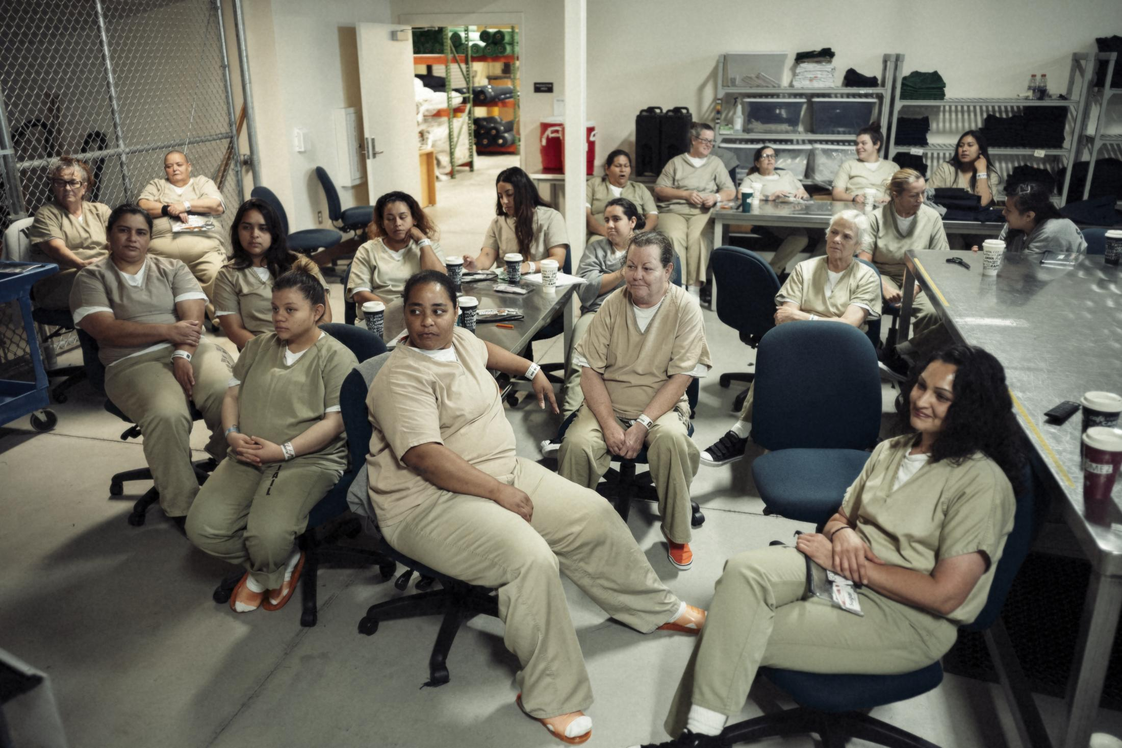 Women enrolled in honors/work programs at Las Colinas correctional facility get additional freedoms.  Women take a break from sewing prison uniforms to watch Downton Abbey.