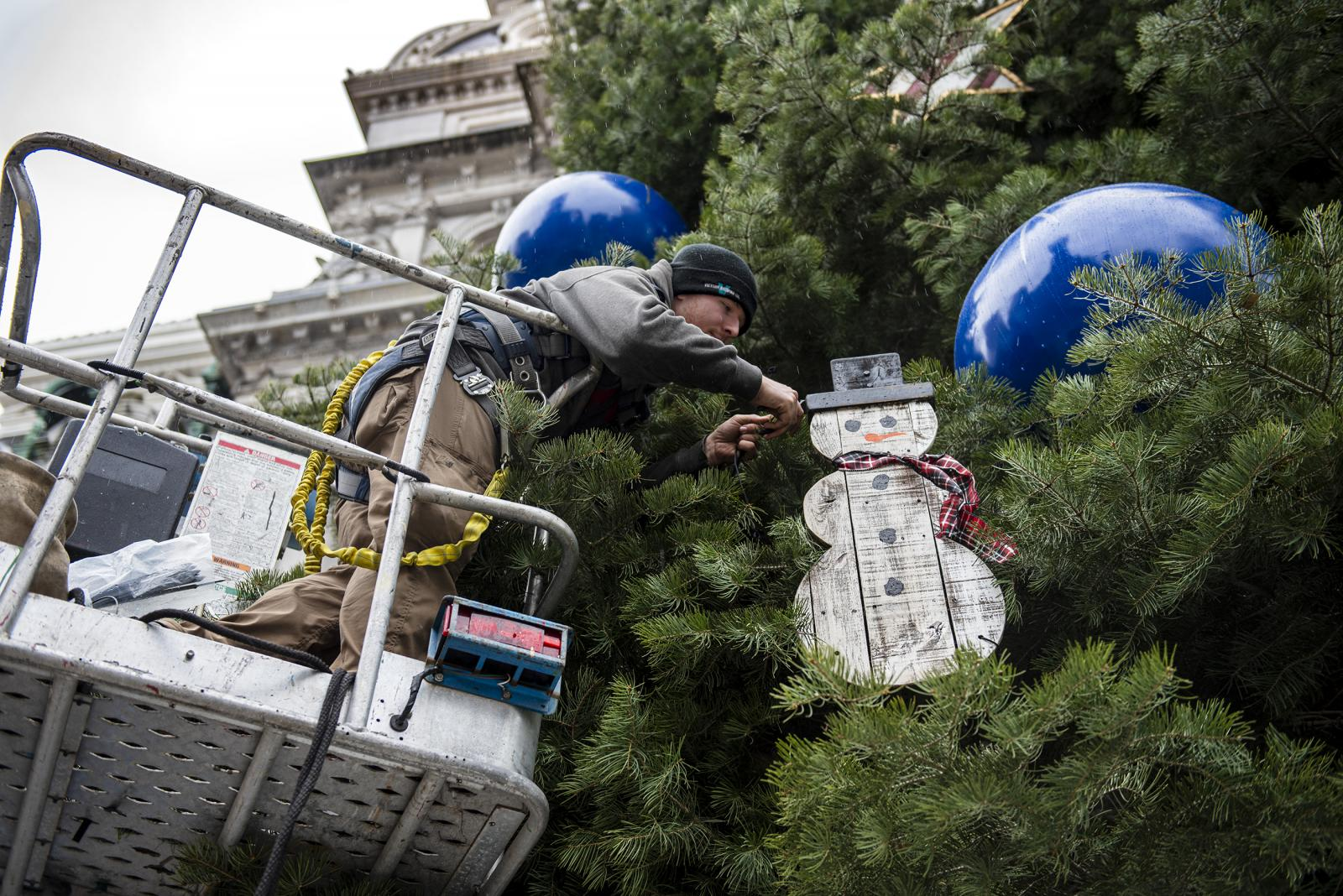 A crew from Proof Productions decorate the City's holiday tree at City Hall in Philadelphia, Pa, on Nov. 22, 2019. Ornaments includes colorful holiday balls, sleds, Christmas stockings, snowmen and snowflakes.
