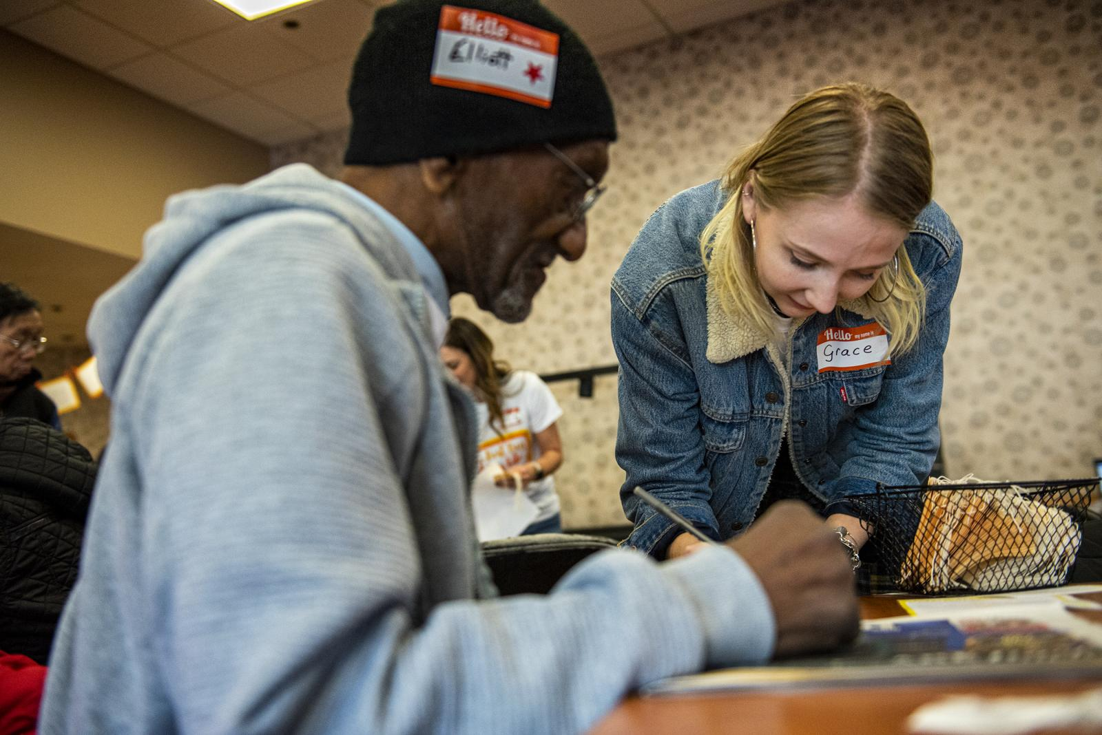 Grace Pfeifer, 21, a volunteer from the College of New Jersey, helps Elliott Doomes write his stories at the 10th anniversary of Best Day of My Life So Far, on Friday, Nov. 8, 2019, at Philadelphia Senior Center, in Philadelphia, Pa.