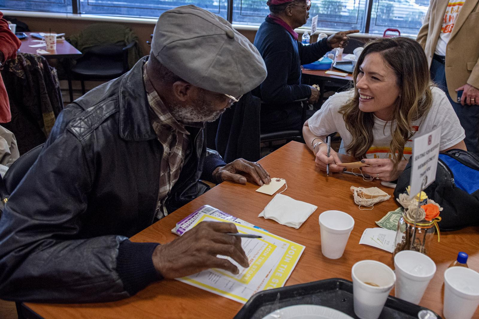 Keli Fazio, a professor from the College of New Jersey, talks with Jonathan White, 92, at the 10th anniversary of Best Day of My Life So Far to help tell seniors' stories, on Friday, Nov. 8, 2019, at Philadelphia Senior Center, in Philadelphia, Pa.