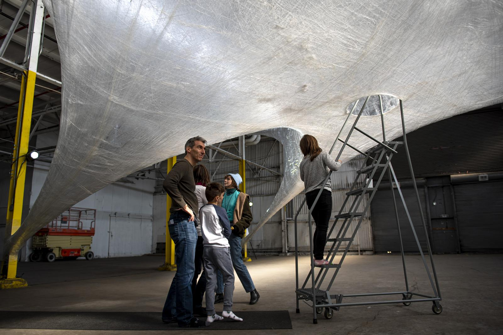 Michael Insogna and his family get ready to enter the cocoon in the Building 694 at the Navy Yard, in Philadelphia, Pa, on Sat, Nov. 9, 2019.