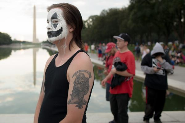 A demonstrator in the Juggalo March on Washington stands in the National Mall after the march has finished on September 16, 2017 in Washington, D.C.