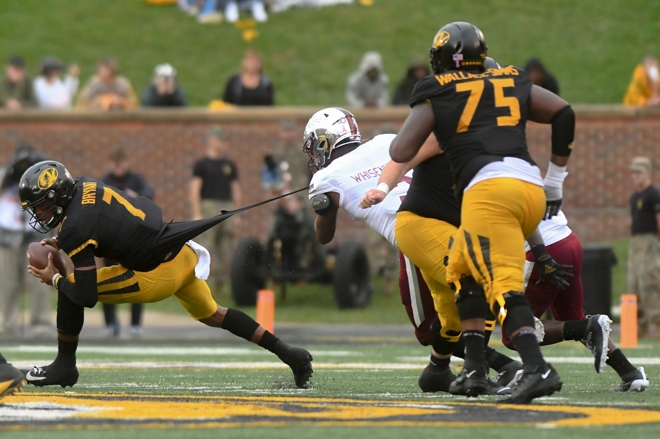 Missouri quarterback Kelly Bryant dodges a sack by a Troy defensive player on Farout Field at Memorial Stadium on Saturday, October 05, 2019.