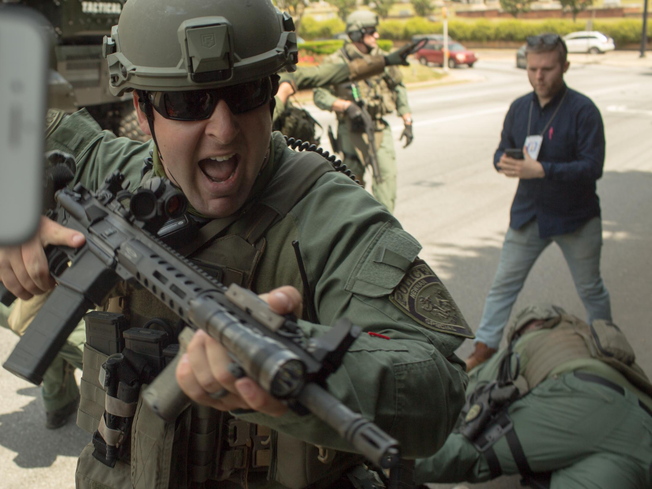 A Newnan police officer points an AR-15 into a crowd of protesters and members of the press while arrests were being made during the No Nazis in Newenan demonstrations on April 21, 2018, in Newnan, GA.