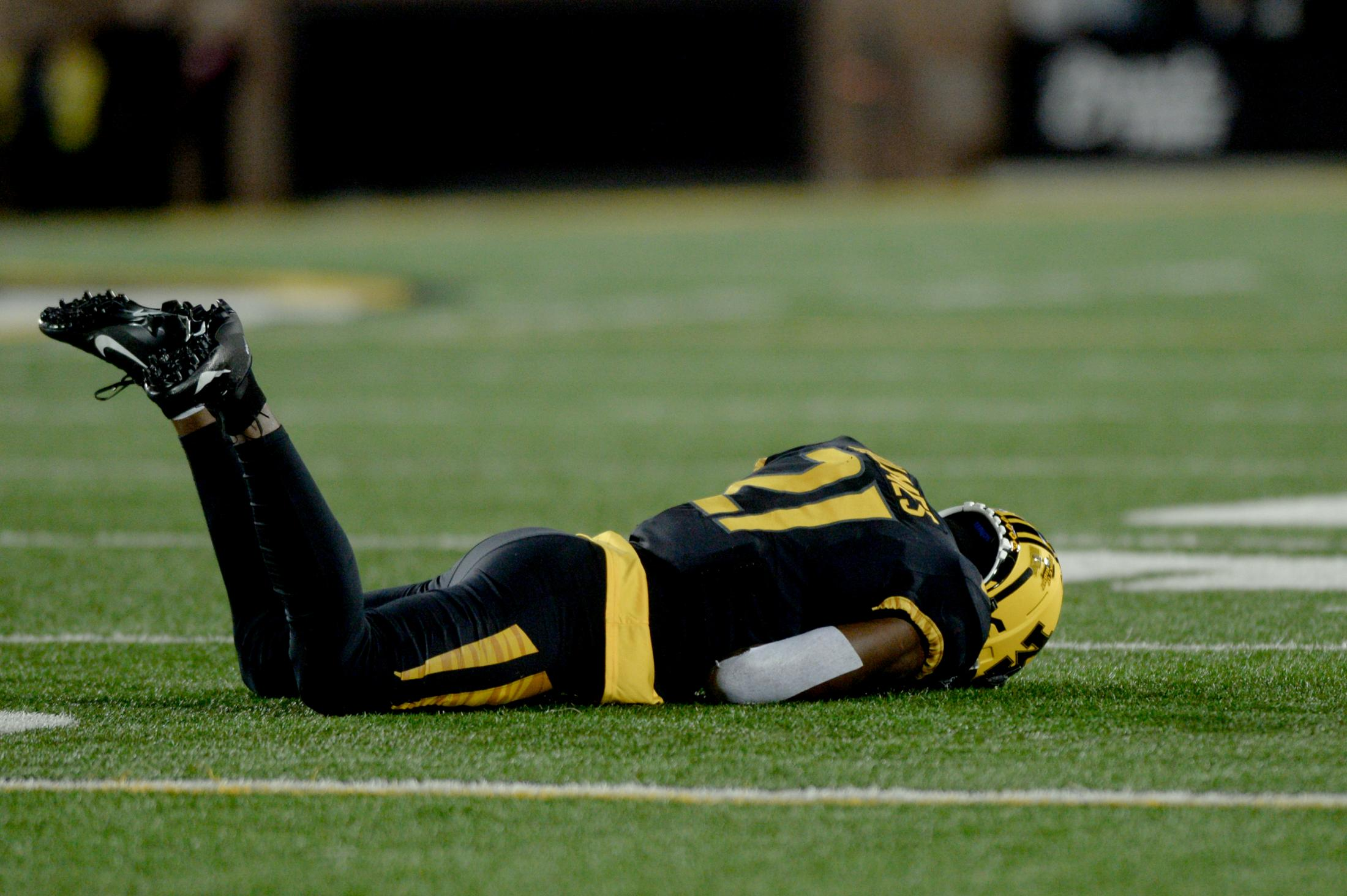 Missouri defensive back Christian Holmes lies on the field after a play during Missouri's matchup with Tennessee on Saturday, November 23, 2019, on Faurot Field at Memorial Stadium.