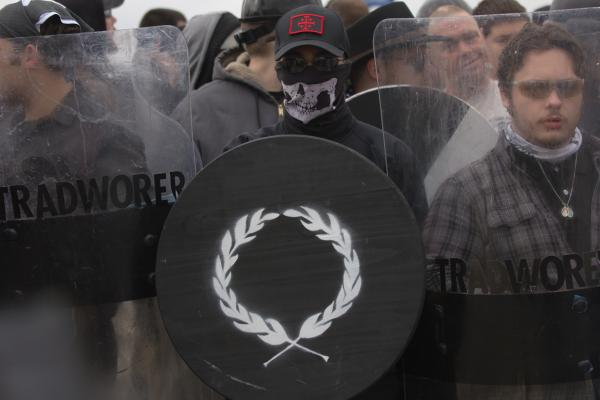 Protesters from the Traditionalist Workers Party stand at the edge of the protest with riot shields in Shelbyville, TN on October 28, 2017.