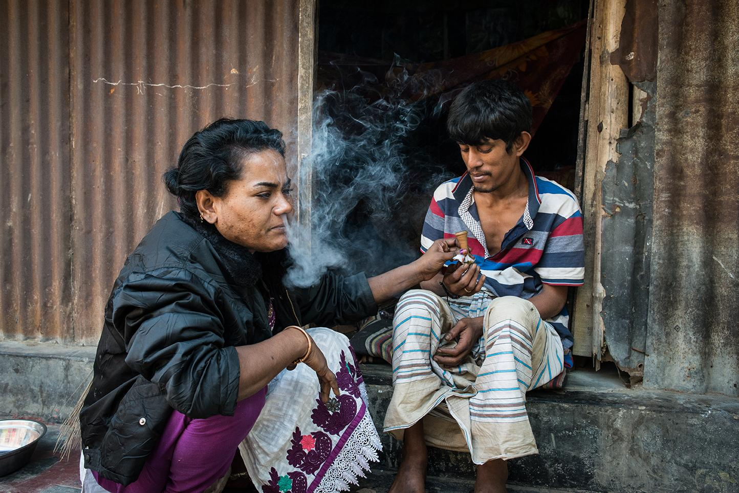 Nilu, 30 is a sex worker who has been staying in the brothel for twenty years. She started working when she was ten years old in Daulatadia Brothel in Daulatadia, Rajbari, Bangladesh. She is heavily addicted to yaba, a form of methamphetamine that is smuggled from Myanmar where it is produced and across the border into Bangladesh. Daulatadia is considered one of the largest brothels in the world and serves roughly 2500-3000 men daily. Bangladesh is the only Muslim country in the world where prostitution is legal. Though legally prostitutes must be at least 18 years of age many are tricked into the profession at a very young age.