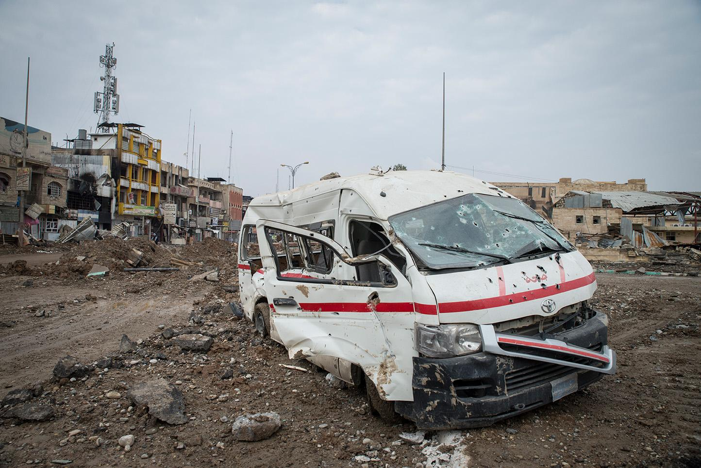A broken down ambulance in the Al-Sukar neighborhood of eastern Mosul. For more than two and half years Mosul, Iraq's second largest city has been under the control of the Islamic State of Iraq and the Levant (Isil). Since October of 2016, Iraq Special Forces have been fighting to take back the city of Mosul from ISIS. On January 24, 2017 the Prime Minister of Iraq declared the entire east side of Mosul had been fully liberated. An offense to take back the west side has yet to begin. According to the United Nations, 750,000 civilians are living under Islamic State control in western Mosul.