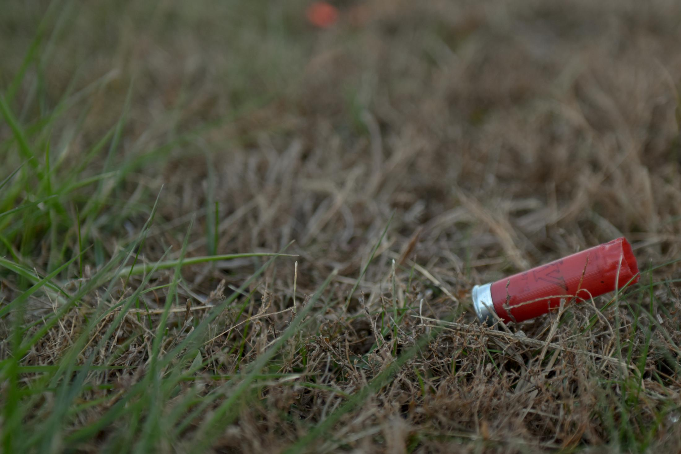 An empty shotgun shell sits on the ground at the Poplar Bluff Gun Club in Poplar Bluff, Missouri on November 9, 2019. Poplar Bluff High School received the most money from the NRA Foundation between 2010 to 2017 out of all K-12 schools, a total of $42,222 from three grants.