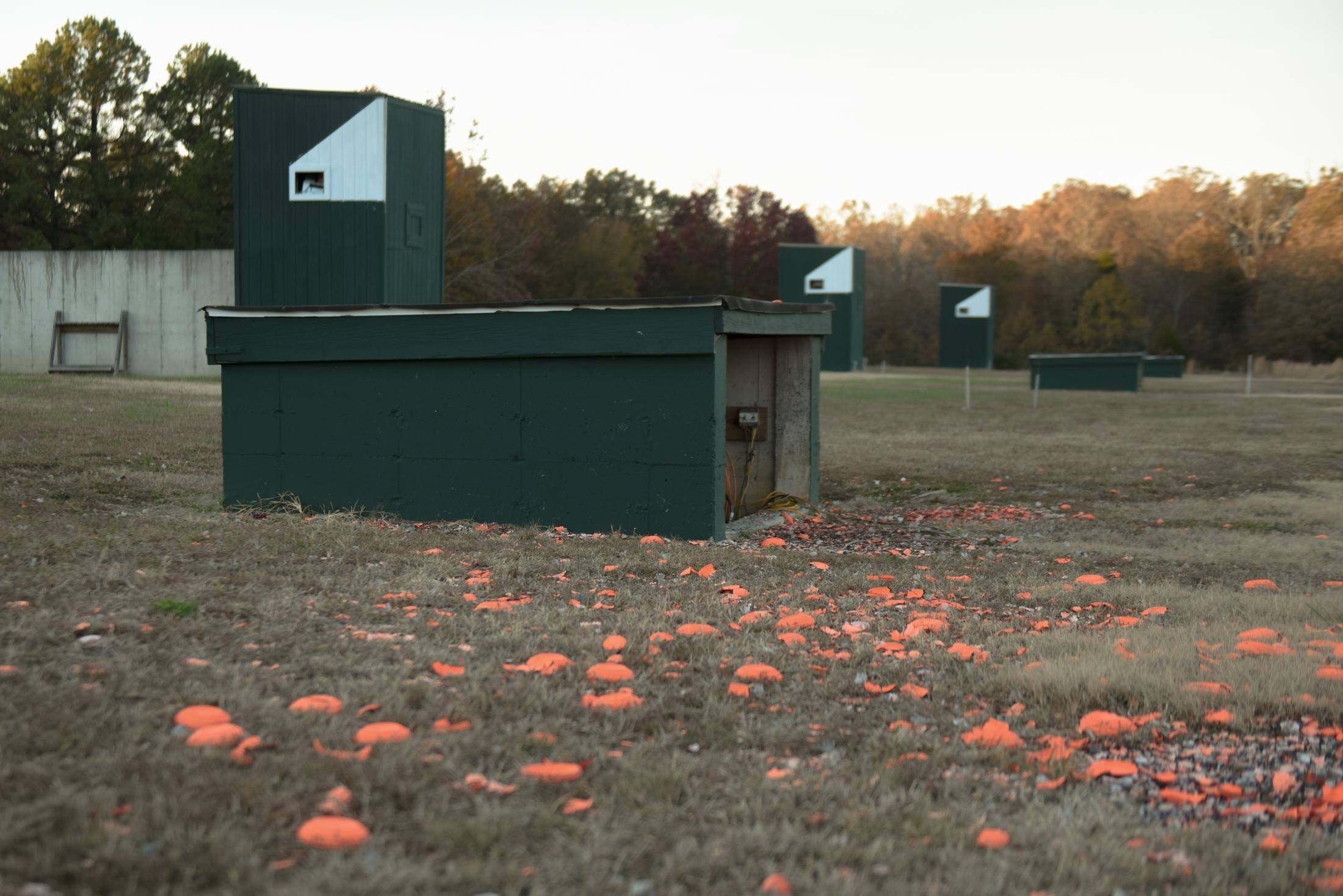 Clay birds for trap shooting litter the ground at the Poplar Bluff Gun Club on the trap shooting range in Poplar Bluff, Missouri on November 9, 2019. Missouri 4-H shooting sports has seen an increase, too, going from 6,400 members in 2010 to around 8,000 in 2019.