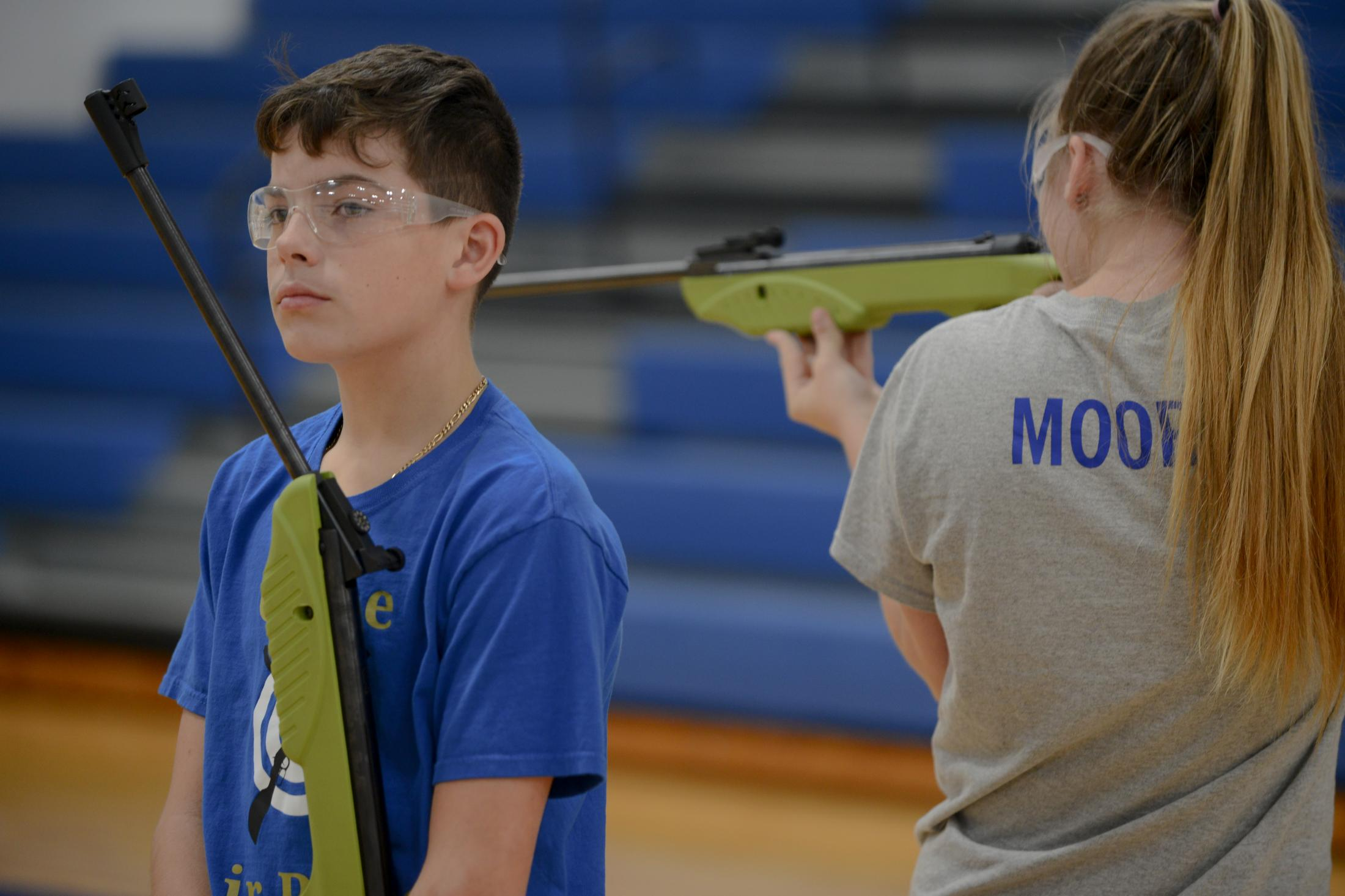 Caden Faucett, 13, from Crane, Missouri stands with his air rifle open after completing a round of shooting at the Student Air Rifle Program tournament at Clever High School on November 14, 2019. NRA money to Missouri schools increased from $29,100 in 2010 to nearly $158,000 in 2017.