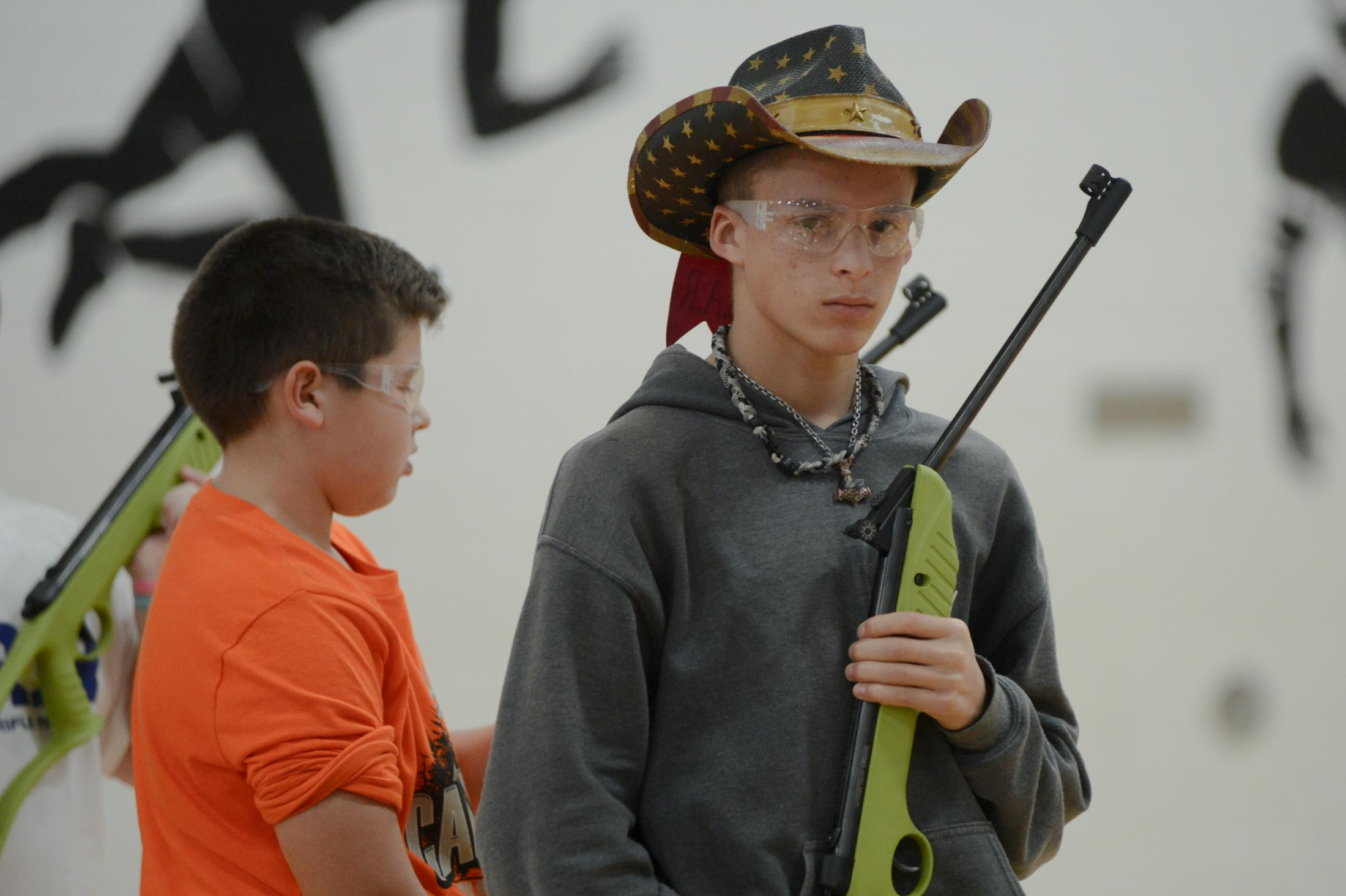 Tristan Record, 15, from Spokane, Missouri stands with his empty air rifle after shooting in a round at Student Air Rifle Program Tournament at Clever High School on November 14, 2019. Tristan took first place in the high school individuals boys category.