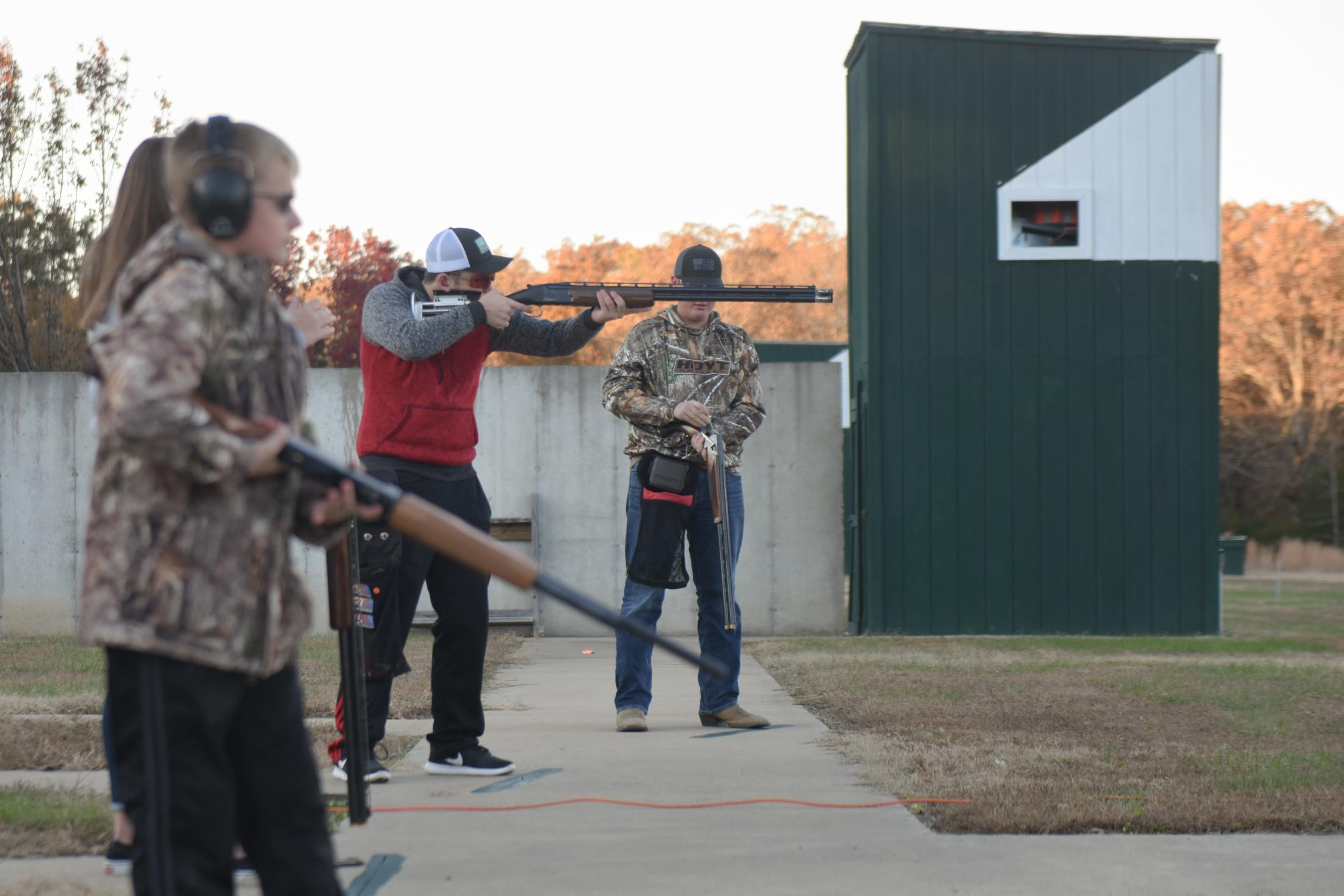 Garret Cooper, 15, center, raises his shotgun during a round of trap shooting at the Poplar Bluff Gun Club in Poplar Bluff, Missouri on November 9, 2019. The Poplar Bluff High School team is one of nearly 80 school-supported organizations in the state of Missouri that received grants from the NRA Foundation from 2010 to 2017.