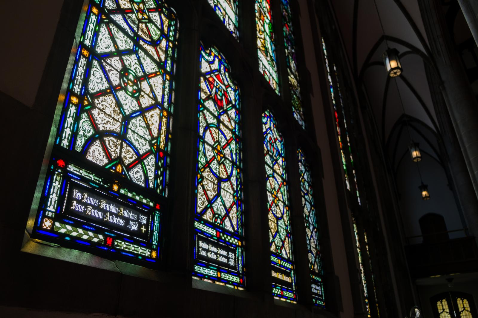 Stained glass windows cover the largest walls of the sanctuary.