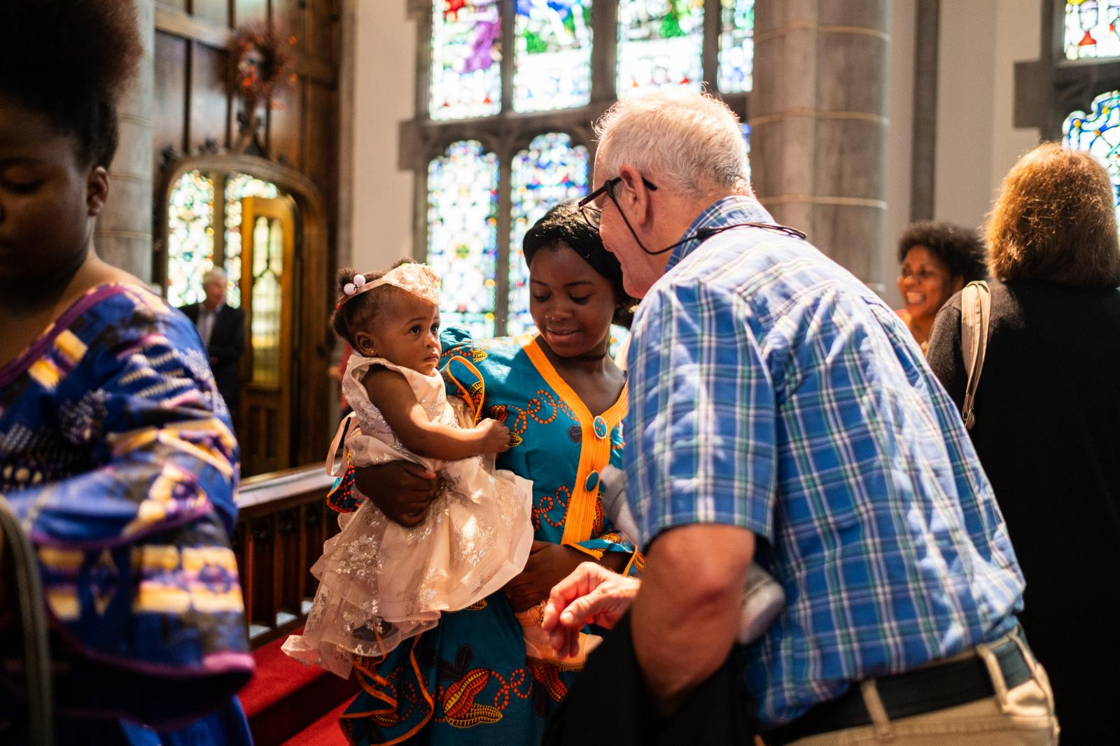 Faraha was baptized during the service this week and she is being greeted by other members of the church.