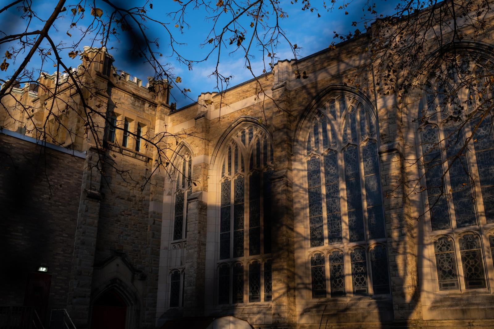 Exterior of the University United Methodist Church during golden hour.
