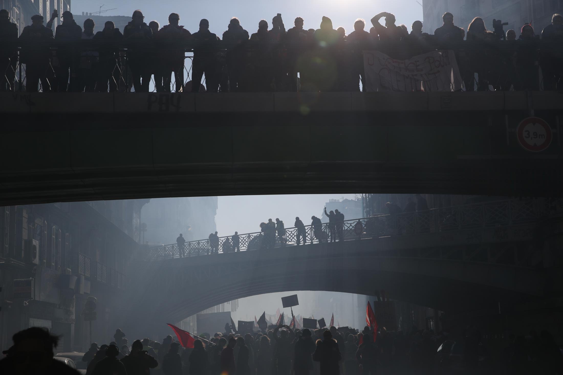 Protesters march during a mass stirke in Marseille, southern France, Tuesday, Dec. 10, 2019. French airport employees, teachers and other workers joined nationwide strikes Tuesday as unions cranked up pressure on the government to scrap upcoming changes to the country's national retirement system. (AP Photo/Daniel Cole)