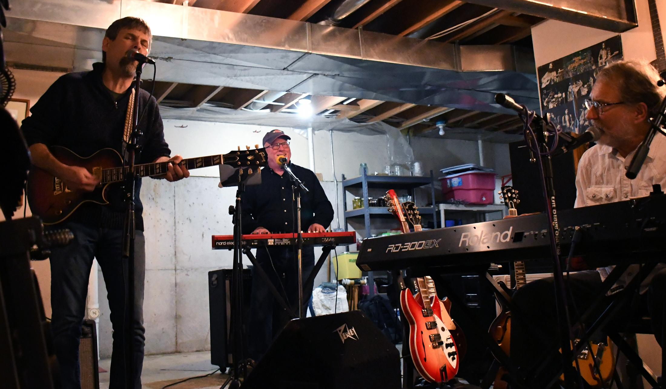 From left to right, Flyover Country members Soren Larsen, Brad Crum and Steve Watts rehearse at Watts basement on Wednesday, Nov. 13, 2019 in Columbia, Missouri. The band was preparing to play at the Rocheport General Store, their next concert after playing at Rose Music Hall in the beginning of the month.