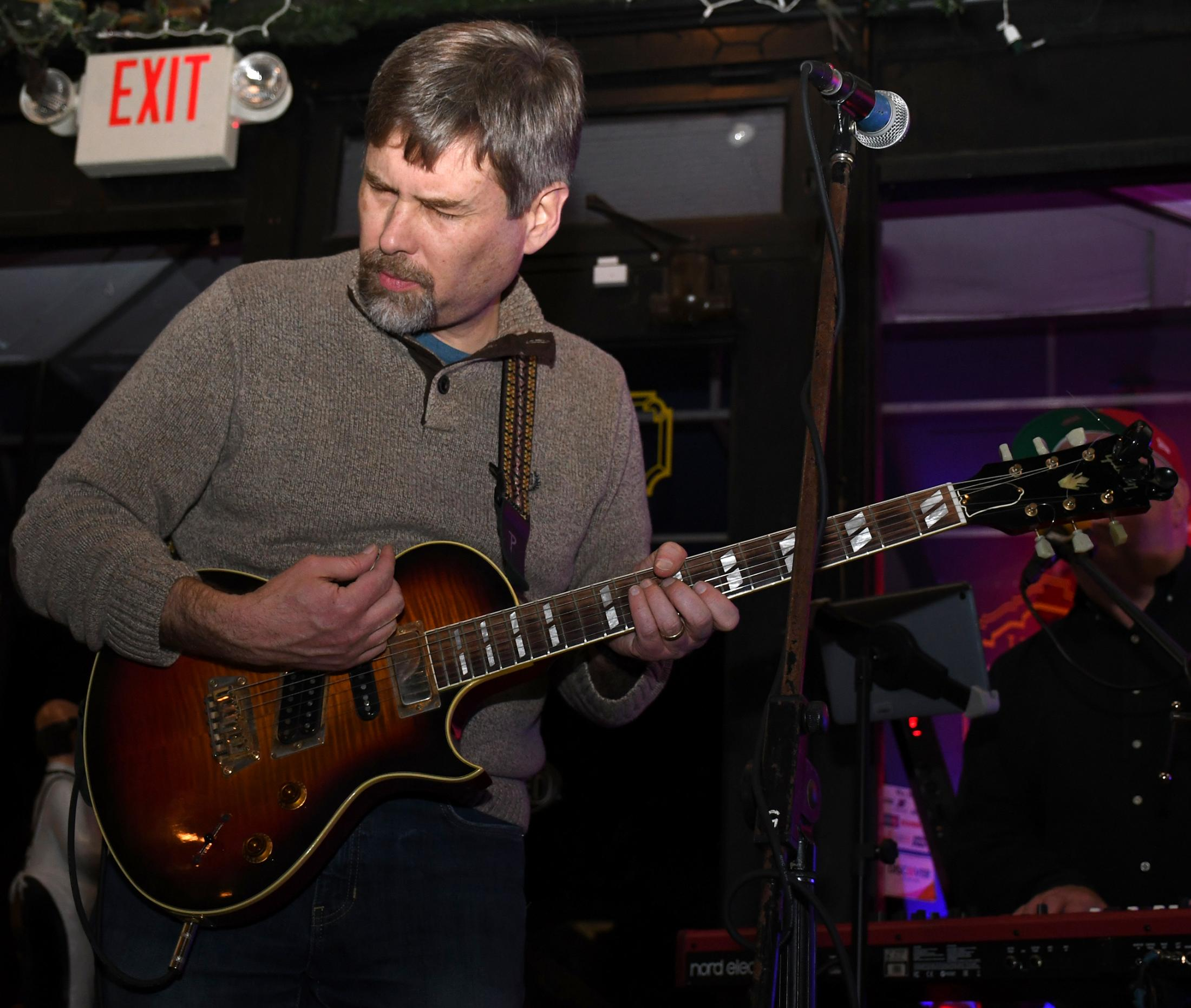 """Larsen plays the guitar at Flyover Country's concert at the Rocheport General Store on Friday, Nov. 15, 2019, in Rocheport, Missouri. The store is tiny for a rock concert, that said, the musicians could not play as loud as normally, """"The volume we played at the rehearsal is going to be the same that we are going to do here, it's a shame that we cannot use our full potential,"""" said Larsen."""