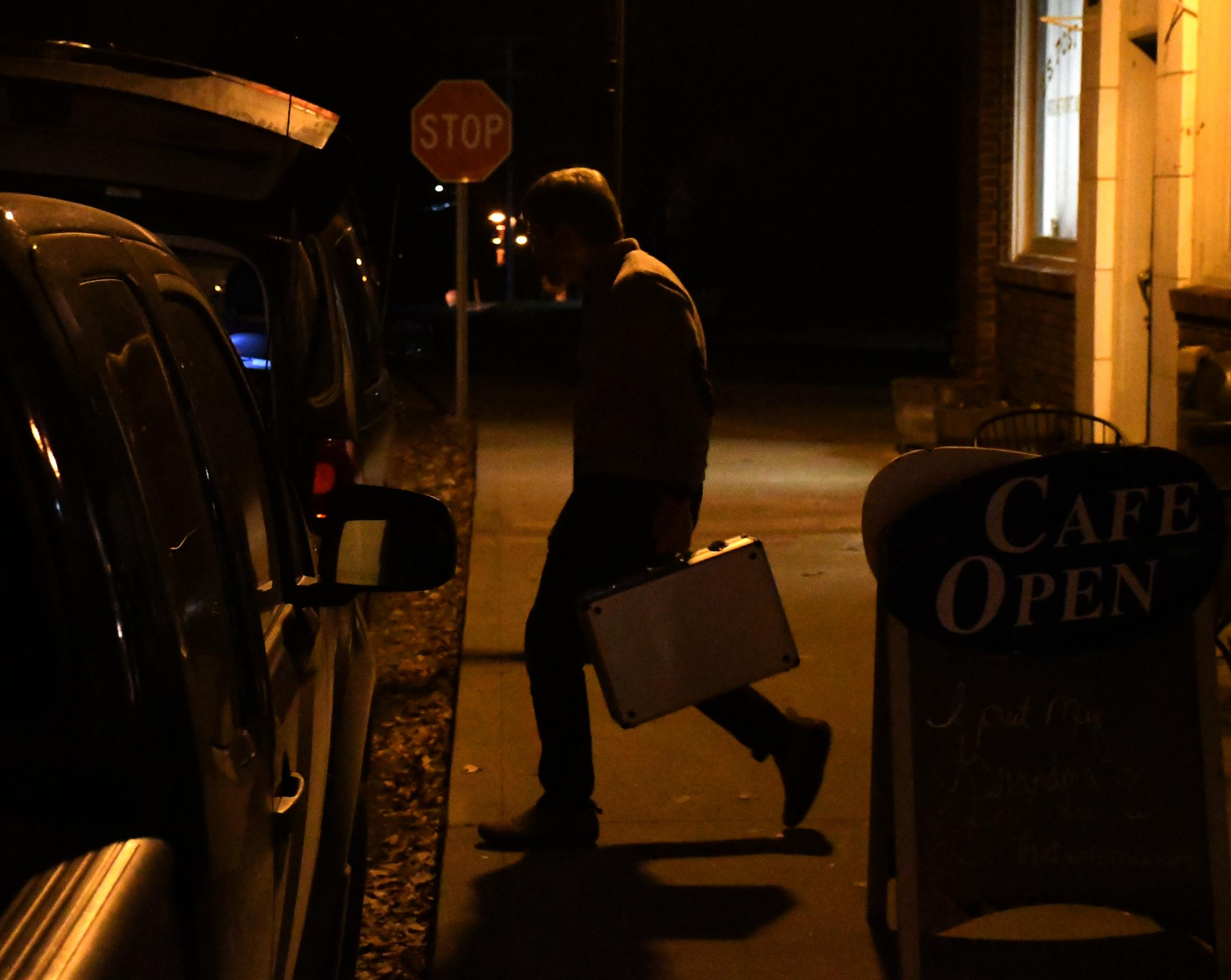 Larsen walks to his car to pack the band instruments and equipment, in front of the Rocheport General Store on Friday, Nov. 15, 2019, in Rocheport, Missouri. This process is really long and normally occurs right after they finish performing, the fact that they don't have an assistant make the job worse.