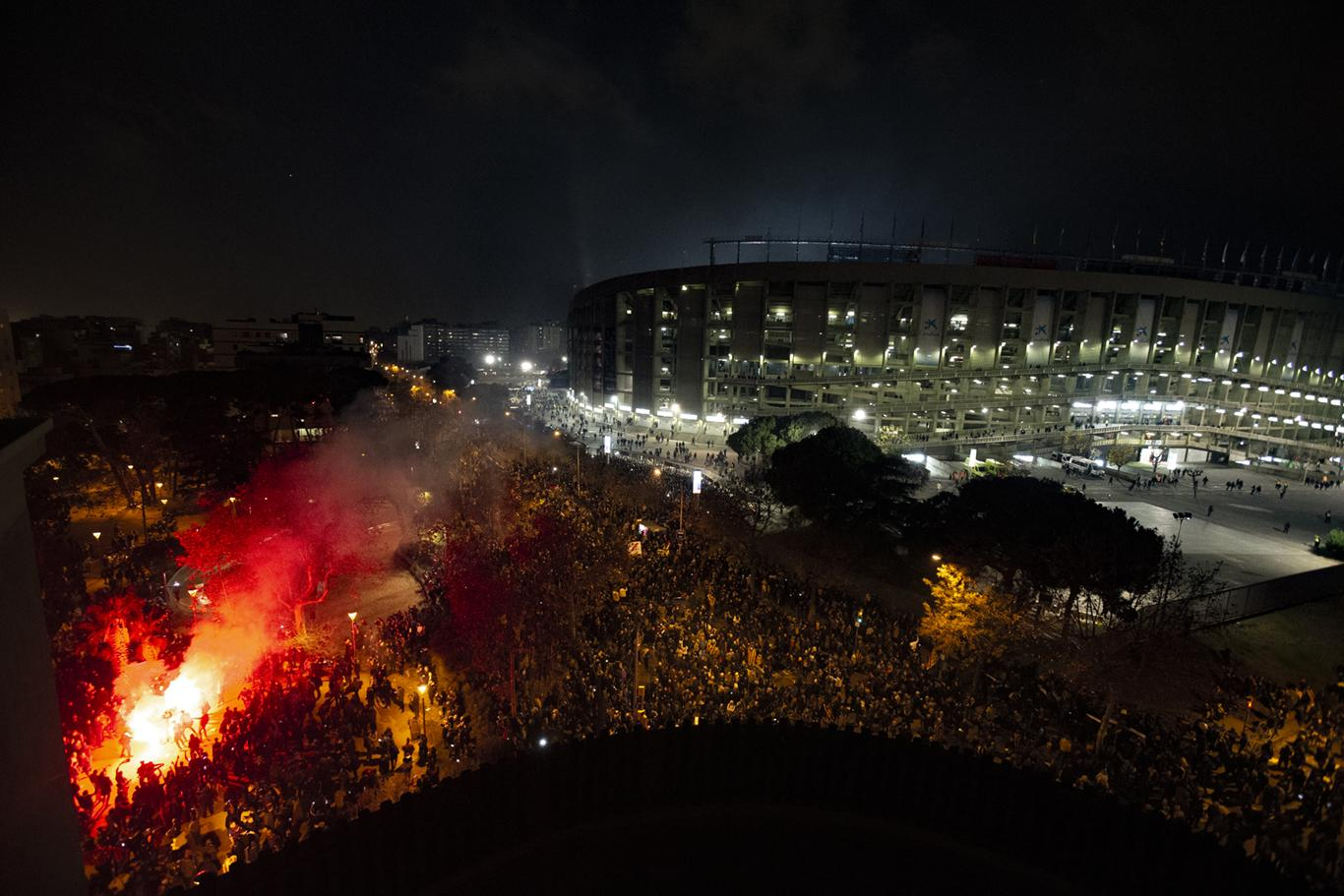 Catalan pro-independence demonstrators gather outside the Camp Nou stadium ahead of a Spanish La Liga soccer match between Barcelona and Real Madrid in Barcelona, Spain, Wednesday, Dec. 18, 2019. Thousands of police and private security personnel were deployed Wednesday in and around Barcelona's Camp Nou stadium to ensure that a protest over Catalonia's separatist movement does not disrupt one of the world's most-watched soccer matches. (AP Photo/Joan Mateu)