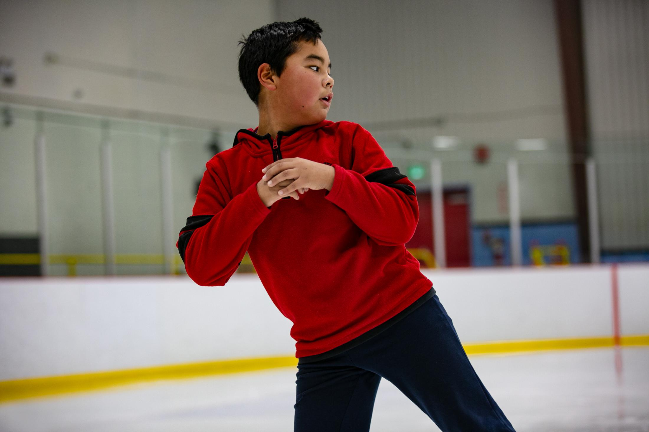 Kaniq Allerton takes part in figure skating practice. Kaniq and his sister, Béatrice, have been figure skating for a few years. During practice at the ice rink in Iqaluit, Kaniq uses the same focus and confidence he has when on the land.