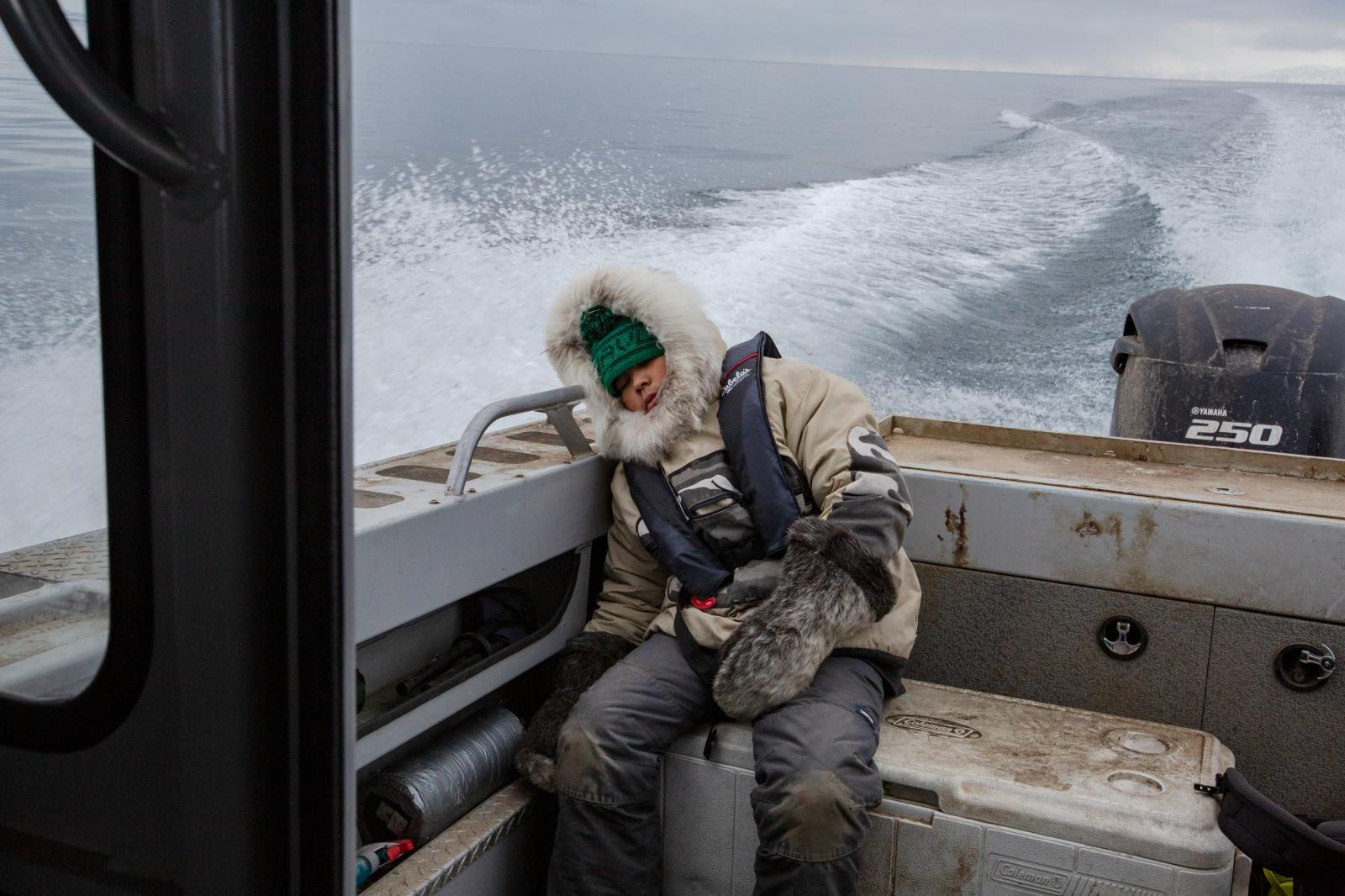At the end of Kaniq's first hunt in November of 2018, he falls asleep at the back of the boat.