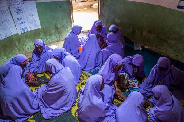 Teen girls discuss during a breakout session in the out of school safe space. The curriculum used in the out of school safe space is made to suite what the girls can learn, thereby increasing their willingness to learn.