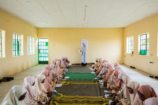 Teen girls from Government Secondary School (G.S.S), Kofar Gayan, Zaria, look towards their mentor during a session in the safe space in the school.