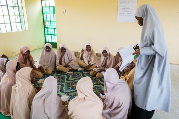 Salamatu Yahaya mentors the teen girls during a session in the safe space in G.S.S, Kofar Gayan, Zaria.
