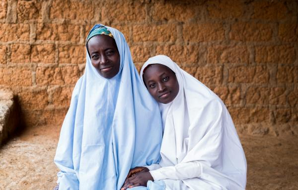 Maimuna Saleh 16, and her mother in their home in Zaria. Maimuna is one of seventeen girls that attend the vocational training weekly.