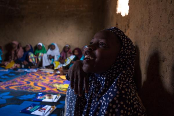 A young girl giggles during a session in the out of school safe space in Marwa community, Zaria.