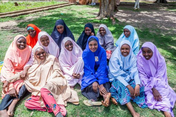 A group of cascading mentors and interns at the Centre for Girls Education pose for a portrait. The cascading mentors and interns are girls that have passed through safe spaces graduated from secondary school, and are in tertiary institutions.