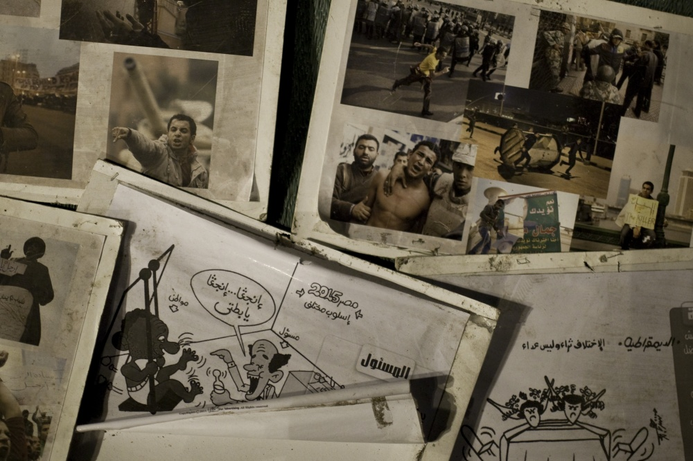 Images and posters of the early days of the revolution remain near the center of Tahrir Square. March 9, 2012