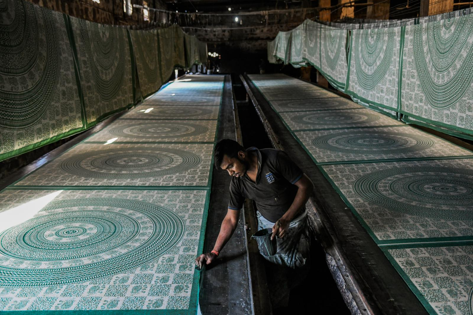 "A border being painted on sheets for The Boho Street company. ""Amazon taught us how to create a brand,"" said Abhishek Middha, the company's founder"