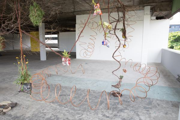 "Installation views of A Walk Sculpture, Lagos, 2019. Produced after 6 days of walking for the Lagos biennial in October 2019.  In this particular installation, ""A Walk"" is about embodied experience, a body moving and the entanglements that occur during this movement. The objects; plants, soil, slabs of concrete, three lemons I bought on the roadside, branches, my 2 min passport photograph and other ephemera are material for this work that represents daily spatio-temporal experiences entangling with the city."
