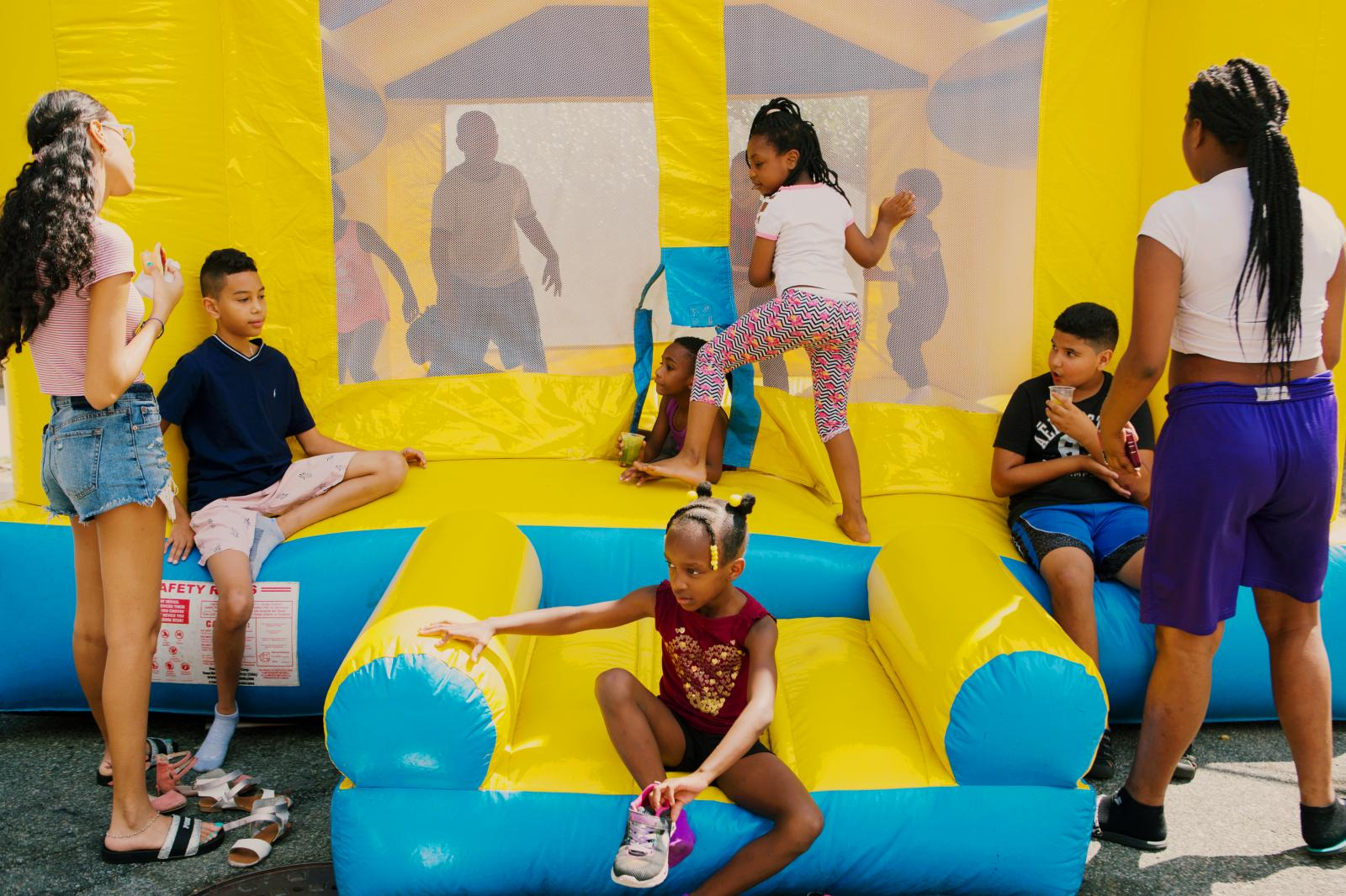 Children play with inflatable bounce house at the block party hosted by The Shiloh Baptist Church of Jamaica in Queens, New York.