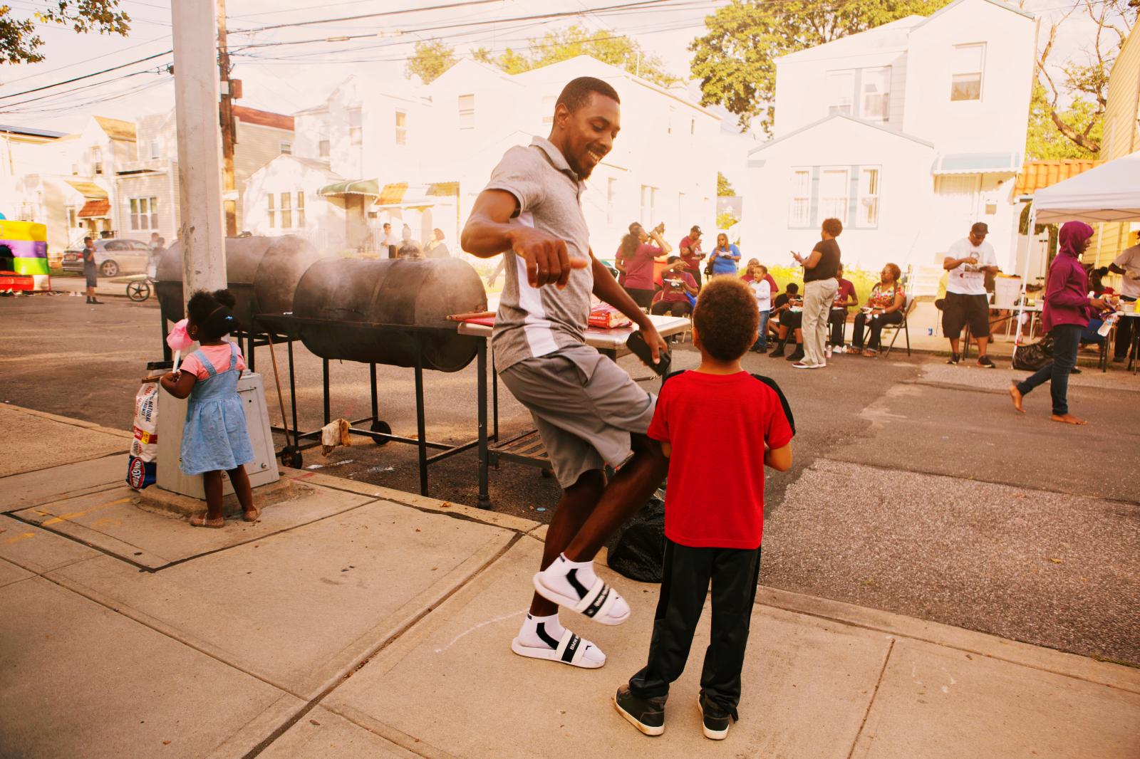 Normando Nelson dances during the block party in Laurelton neighborhood in Queens, New York hosted by Sudan Deane. Nelson loves to see old and young people in the community become one during the block party.