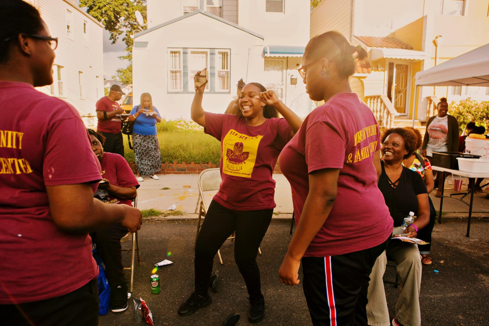 Kiana Betancourt dances during the block party in Laurelton neighborhood in Queens, New York hosted by Sudan Deane. Betancourt is part of Berean Drumline that marched during the block party.