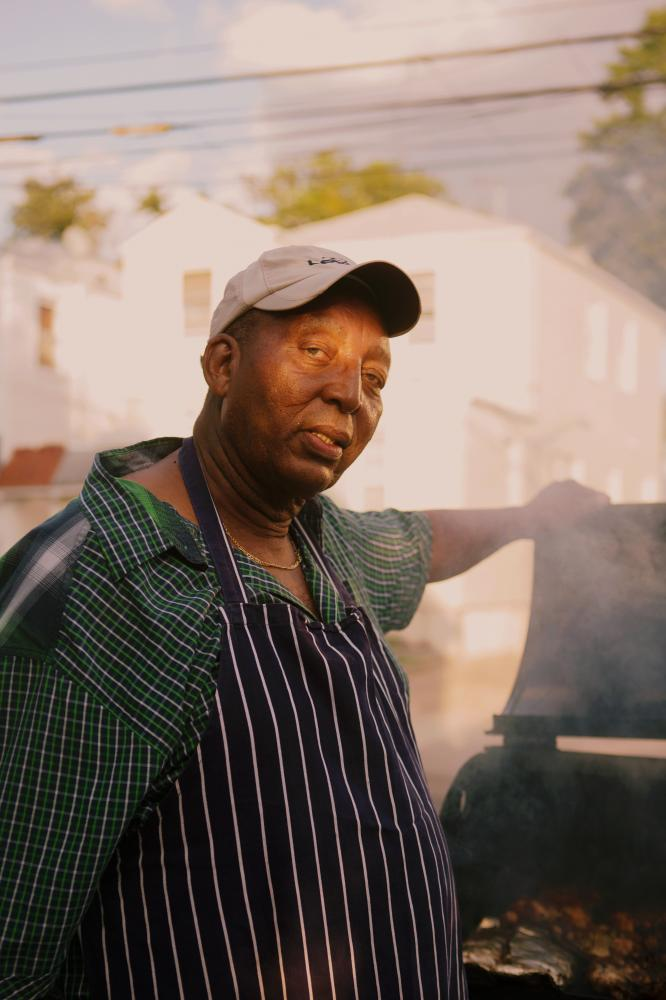 Roy Owens cook friend chicken and port for the block party in Laurelton neighborhood in Queens, New York hosted by Sudan Deane. Owens has been part of the block party for four years now and he enjoys seeing family gather and enjoying beautiful day together.