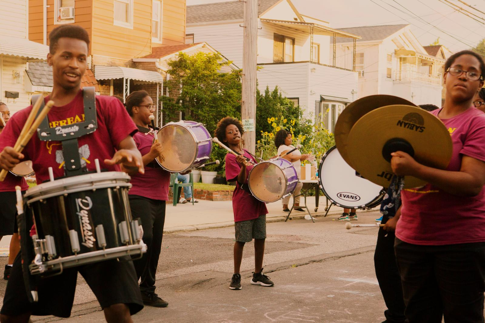 The Berean Community Drumline marches during the block party in Laurelton neighborhood in Queens, New York hosted by Sudan Deane.