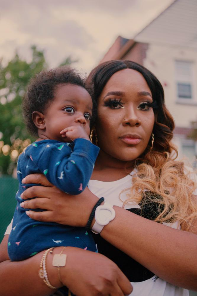 Racquel Jones with her nephew Mason Roland, 5 months, during the block party in Laurelton neighborhood in Queens, New York hosted by Sudan Deane.