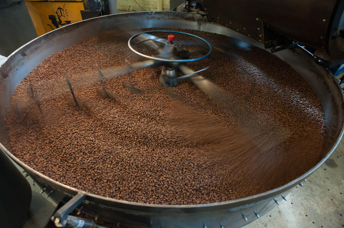 One of the three Gothot roaster in action at the Chicago roasting works. Temperature gets up to 193 °C when the sweet substances in the beans start to caramelize. Once the right flavor is reached, the beans are cooled down and hand packed. ©ChiaraCeolin2013