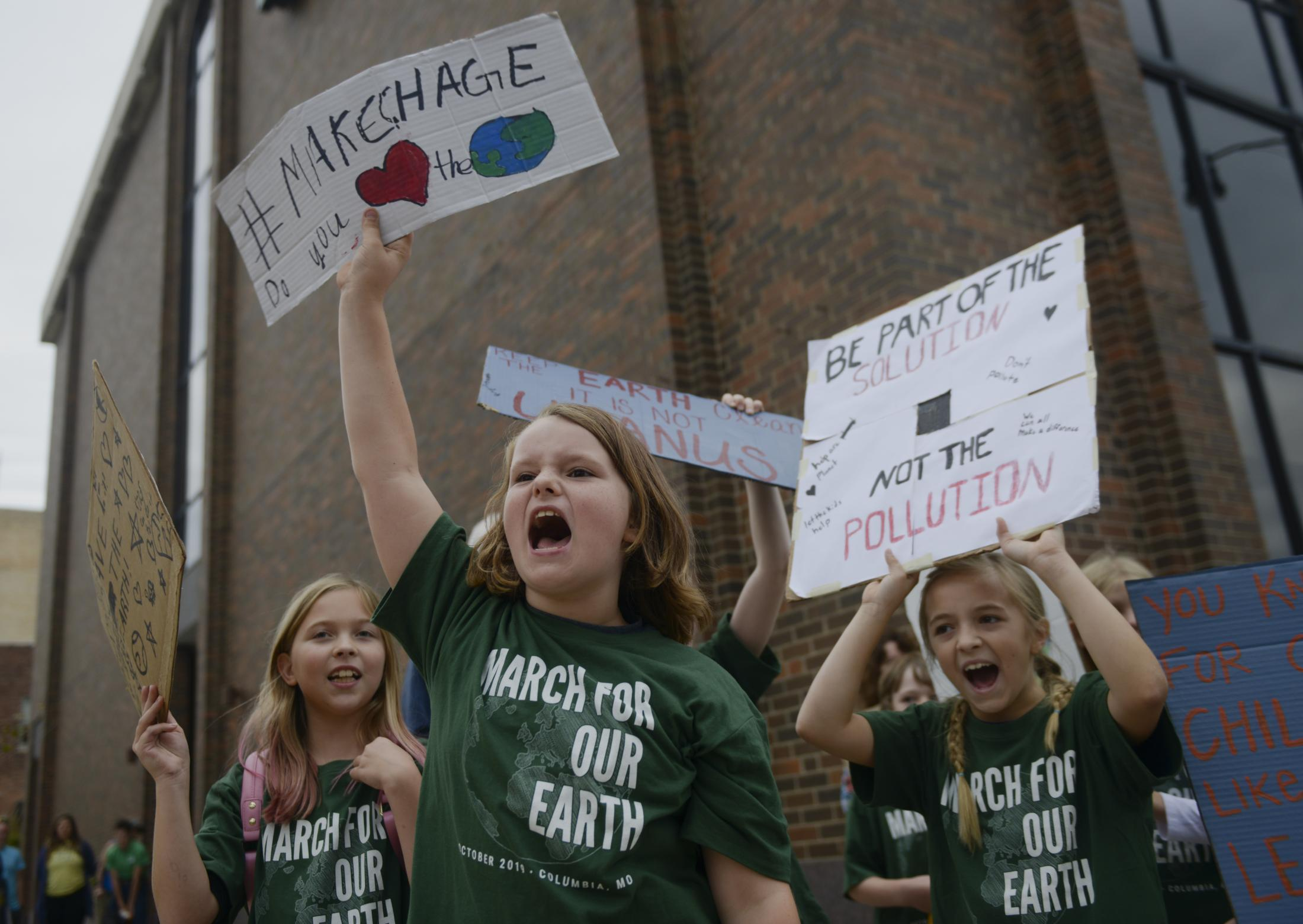 Emma Winter chants while marching at March for Our Earth on Oct. 6, 2019 in downtown Columbia, Missouri. Winter, a fourth-grader at Grant Elementary School, organized the march to raise awareness for climate change.