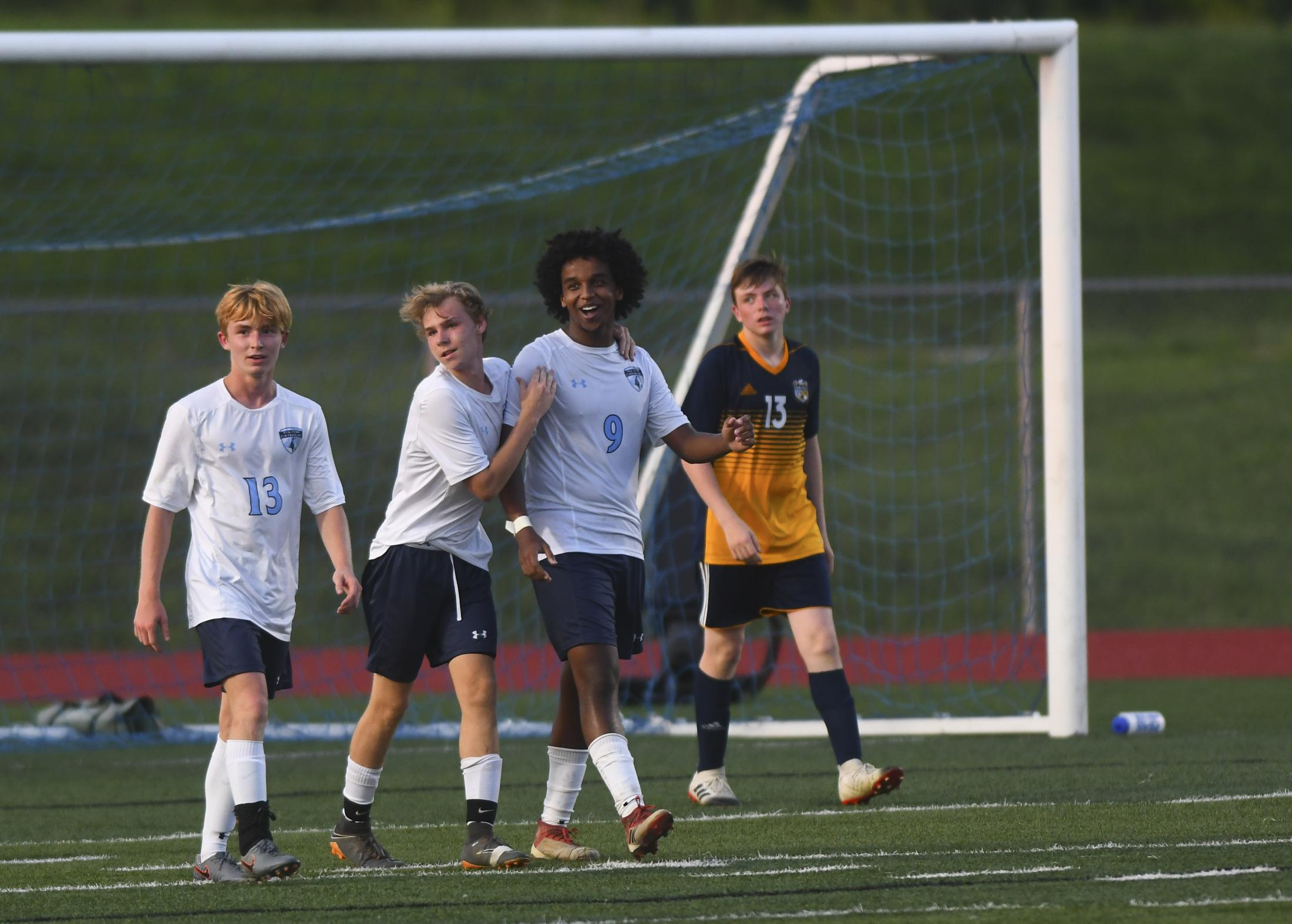 Tyler Stevens, Landon Petri and Lael Haile celebrate after Haile scored the second goal of in the Father Tolton Trailblazer's match against the Battle Spartans on Sept. 3, 2019 in Columbia. Tolton beat Battle 3-1.