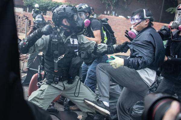 "HONG KONG, CHINA - NOVEMBER 18: Police arrest anti-government protesters at Hong Kong Polytechnic University on November 18, 2019 in Hong Kong, China. Anti-government protesters organized a general strike since Monday as demonstrations in Hong Kong stretched into its sixth month with demands for an independent inquiry into police brutality, the retraction of the word ""riot"" to describe the rallies, and genuine universal suffrage. (Photo by Laurel Chor/Getty Images)"