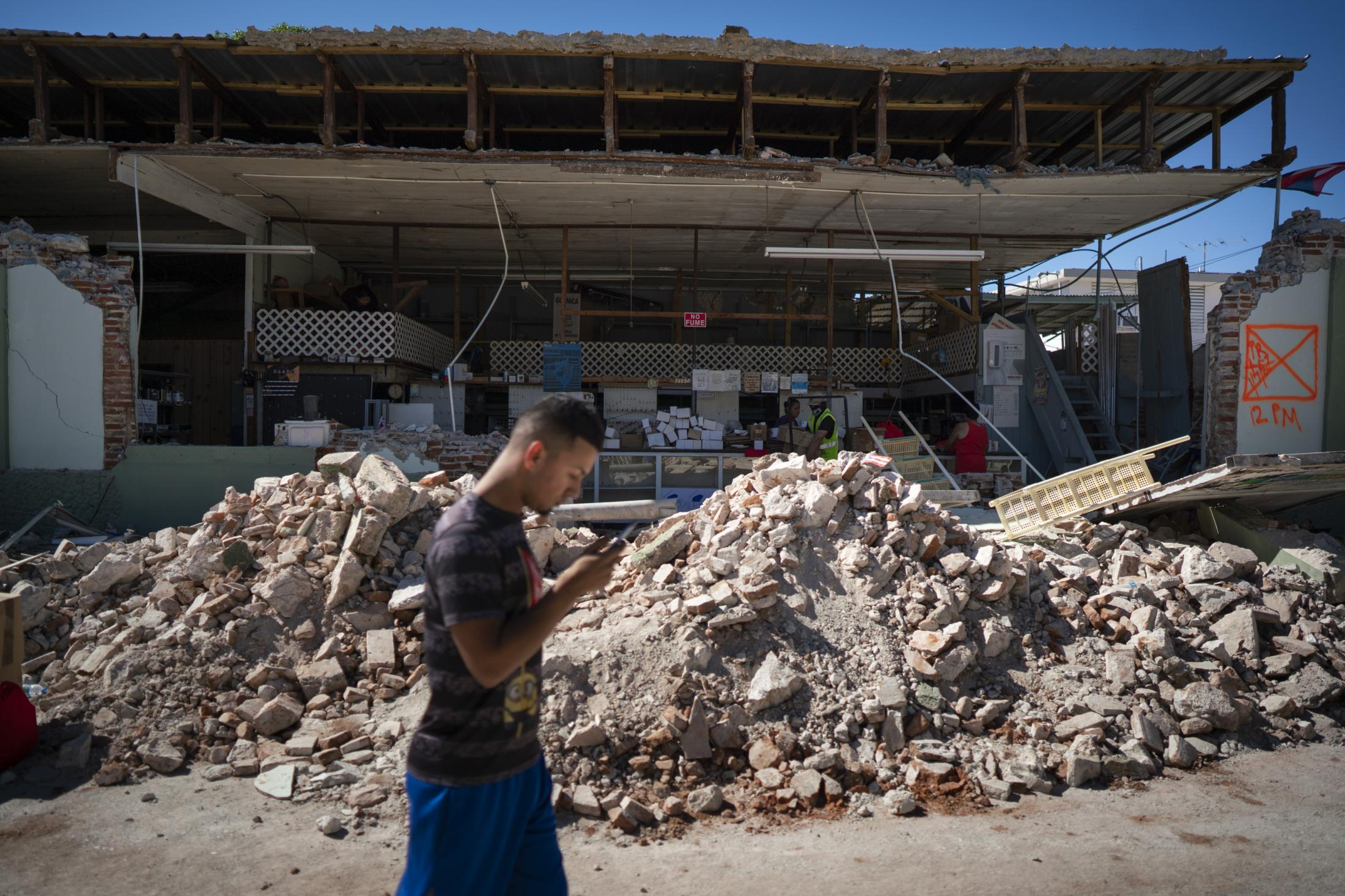 GUANICA, PUERTO RICO - JANUARY 7: People inspect damage and help to take out the merchandise of a local store in Guánica, Puerto Rico after a 6.4 earthquake hit just south of the island January 7, 2020. This morning's earthquake was preceded by a series of smaller quakes in the south of the island with epicentric in Guánica. (Photo by Eric Rojas/Getty Images)